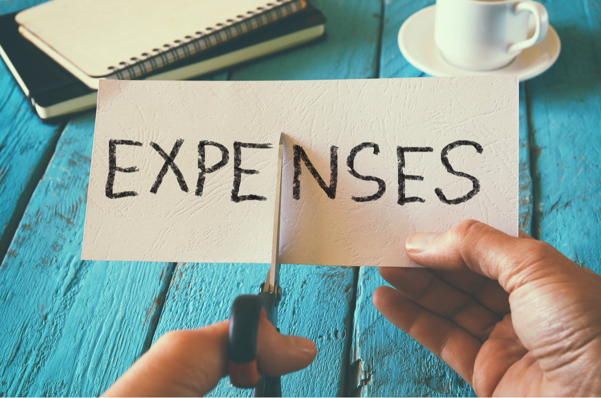 Expenses card being cut.
