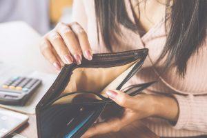 Woman opening an empty wallet.