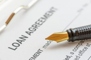 Loan agreement and a pen.