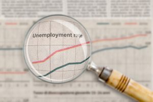 Magnifying glass looking at an unemployment rate.