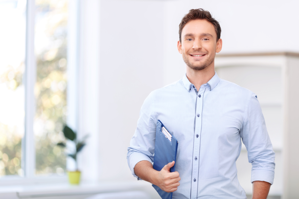 Self-employed salesman standing inside of his house.