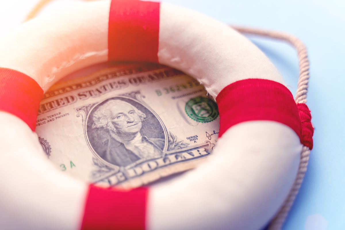 A dollar bill with a lifesaver ring