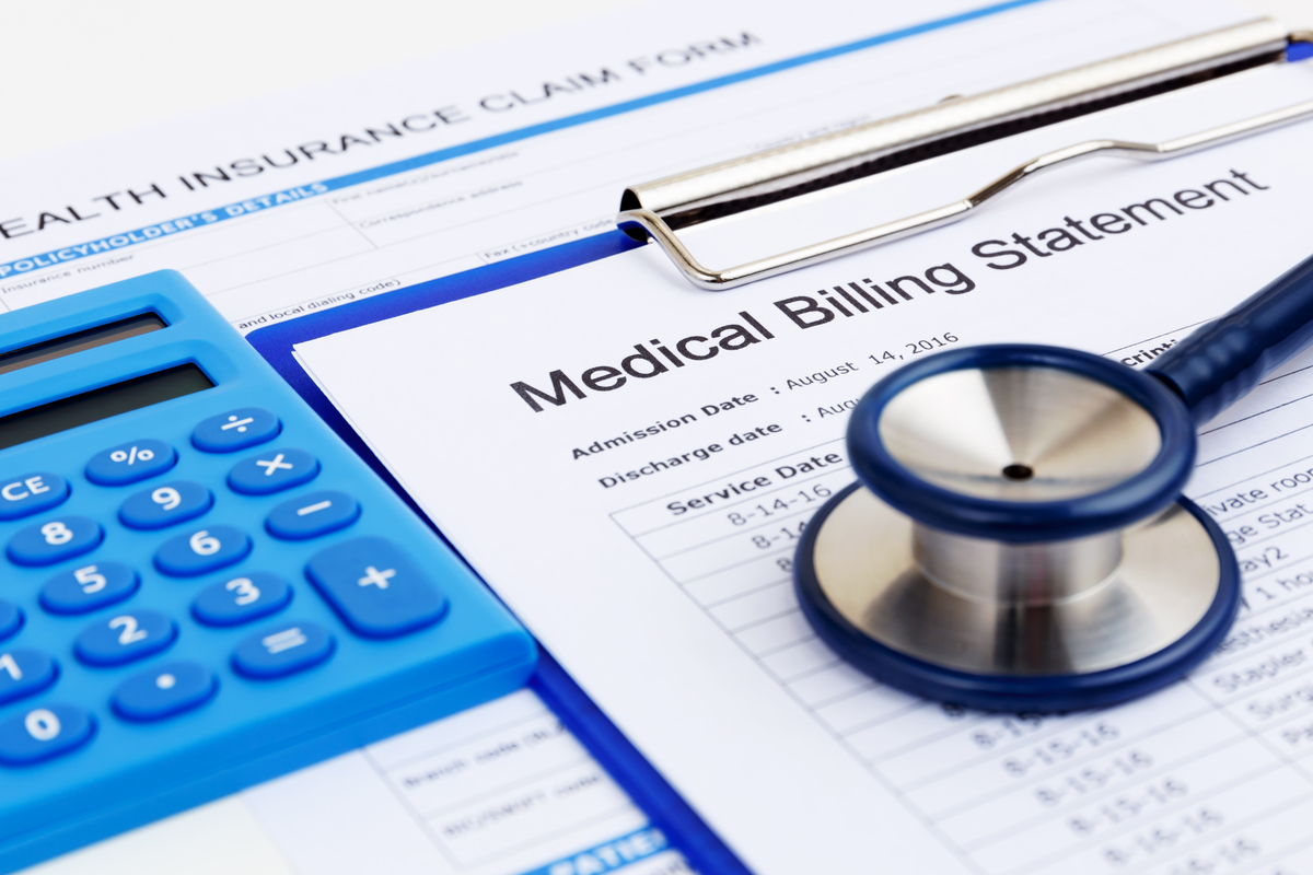 a stethoscope and a medical bill form.